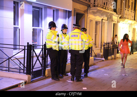 group of police officers on a Saturday night, in Norwich  UK - Stock Photo