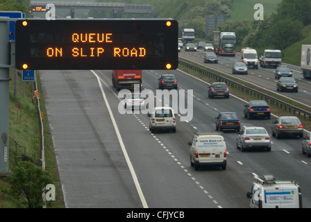 Matrix signs on the M1 at Sheffield advising motorists of queue on sliproad - Stock Photo