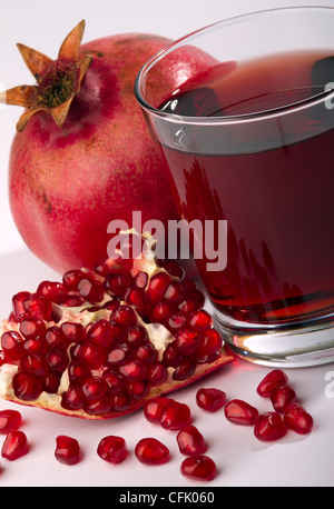 fresh ripe pomegranate and juice in the glass - Stock Photo