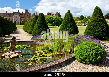 Garden pond with statue and lavender in an english country for Ornamental pond fish uk