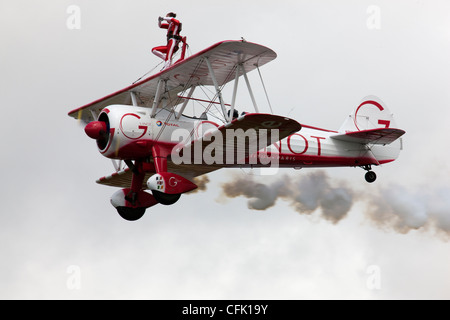 Wing walking on the Guinot biplane formation display team - Stock Photo