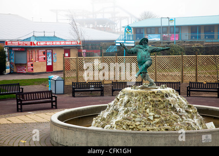 The jolly fisherman statue in a fountain in Skegness Town, Lincolnshire, England UK - Stock Photo