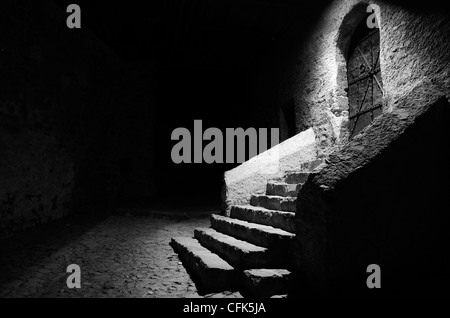 Stairs and door at night, Convento Sabiona, Chiusa, Italy. - Stock Photo