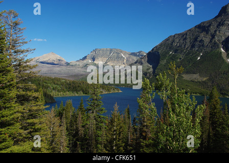 Forests and Rockies around St Mary Lake, Glacier National Park, Montana - Stock Photo