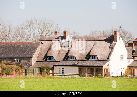 An old thatched cottage near Woodhouse Eaves in Leicestershire, UK. - Stock Photo