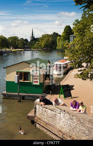 Warwickshire, Stratford on Avon, summer visitors on banks of River Avon passing through the town - Stock Photo
