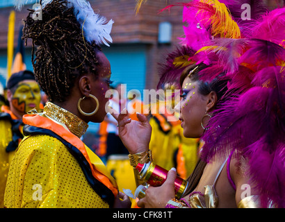 carnival participant has her face covered with makeup prior to participating in the annual national festival of - Stock Photo