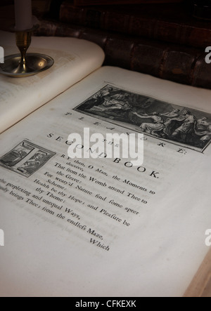 Pleasure the Second Book (Poems On Several Occasions printed in 1718) we also see a part of the candlestick - Stock Photo