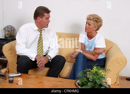 Mature couple talking serious - Stock Photo