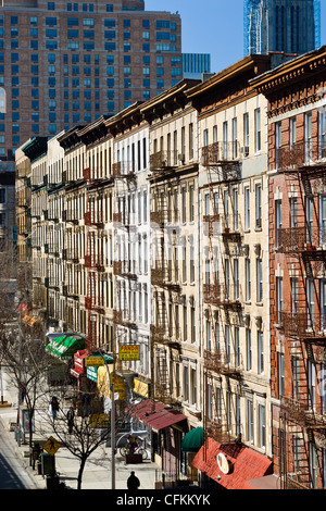 Fire escapes on tenement apartment buildings along upper Broadway in Harlem neighborhood, New York City. - Stock Photo
