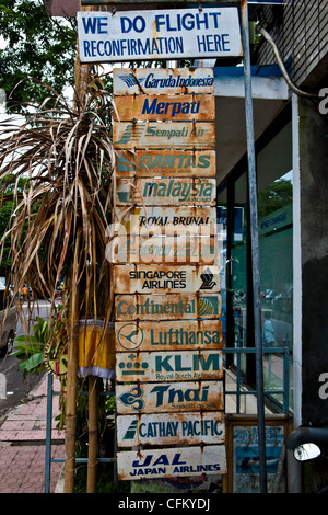 Old signs in the front of a tourism agency, Ubud, Bali, South Asia, Indonesia - Stock Photo