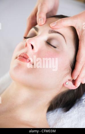 USA, New Jersey, Jersey City, Woman receiving face massage - Stock Photo