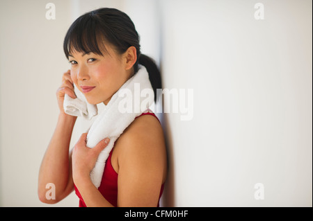 USA, New Jersey, Jersey City, Mid adult woman in gym - Stock Photo