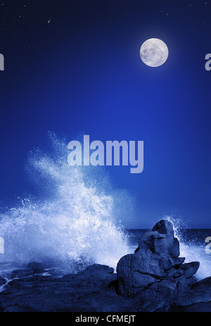 Rising moon over Rocky coastline (Elements of this image furnished by NASA: moonmap http://visibleearth.nasa.gov) - Stock Photo
