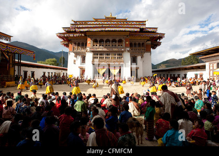View over crowds of spectators to the main courtyard, Gangte, Phobjikha Valley, Bhutan, Asia - Stock Photo