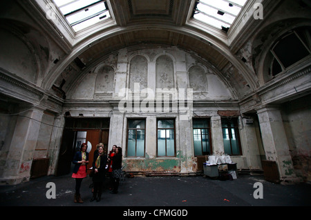 People are seen in the old unused drawing offices of Harland & Wolff in Belfast, Northern Ireland - Stock Photo