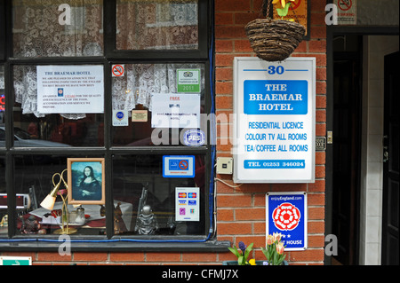 Signs at the entrance to a typical Bed and Breakfast guest house hotel in Blackpool Lancashire UK - Stock Photo