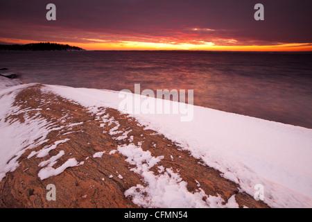 Coastal winter landscape at sunset, at Larkollen in Rygge kommune, Østfold fylke, Norway. - Stock Photo