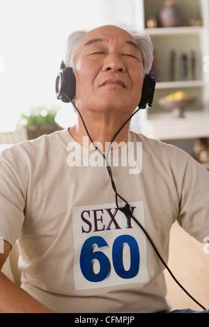 USA, California, Los Angeles, Man with headphones on - Stock Photo
