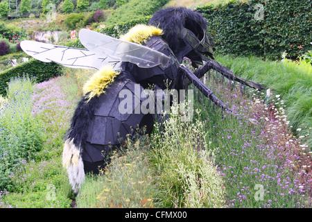 Big bees sculptures displayed in a garden in Eden Project, UK - Stock Photo