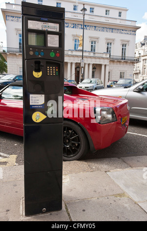 A sports car parked at a Pay & Display ticket machine in the City of Westminster, London, England, GB, UK - Stock Photo