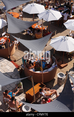 People relax while sitting in a cafe on the beach. Budva. Montenegro - Stock Photo