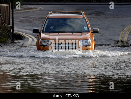 Land Rover Freelander 2 4x4 SUV off roader car wading through deep water - Stock Photo