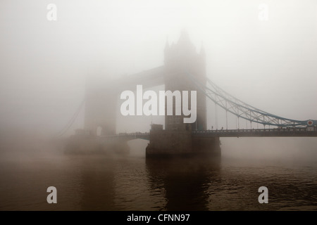 A view of Tower Bridge completely covered in morning mist - Stock Photo