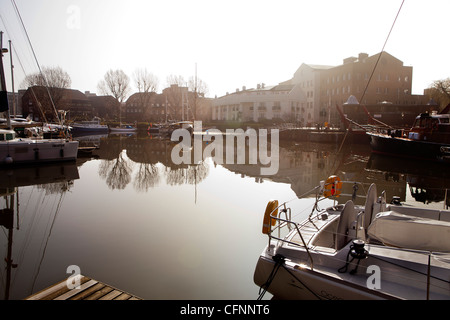 Private residences and yachts in St. Katharine Docks marina, located near Tower Bridge on the river Thames - Stock Photo