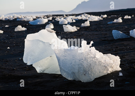 Large pieces of glacial ice washed up on beach, Jokulsarlon glacial lagoon, Iceland - Stock Photo