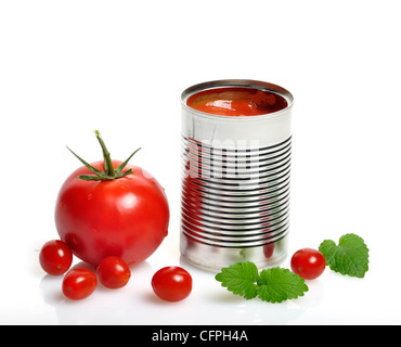 Open Can With Tomato Soup And Fresh Tomatoes - Stock Photo