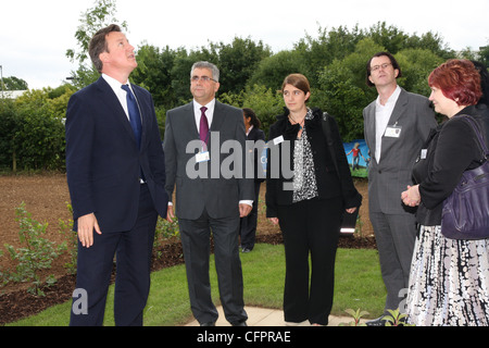 David Cameron looks to the sky whilst attending the launch of new social housing in Oxfordshire. - Stock Photo