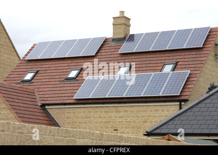 Solar panel roofing on residential property. - Stock Photo