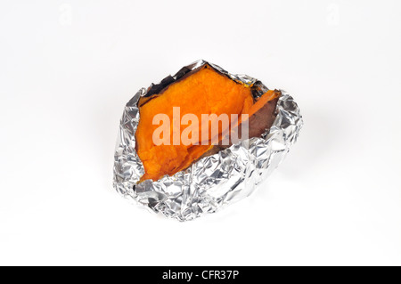 Yam also known as a sweet potato in USA cooked in tin foil and cut in half on white background cut out. - Stock Photo