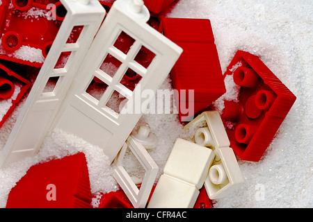 Vintage children's toy bricks depicting house destruction - Stock Photo