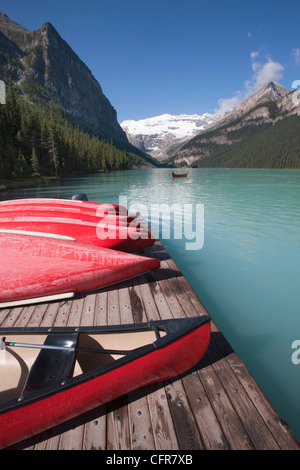 Canoes for hire on Lake Louise, Banff National Park, UNESCO World Heritage Site, Alberta, Rocky Mountains, Canada, - Stock Photo