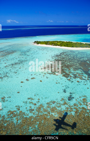 Aerial view of coral reef and deserted island, Maldives, Indian Ocean, Asia - Stock Photo