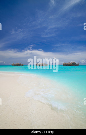 Water villas in lagoon, Maldives, Indian Ocean, Asia - Stock Photo