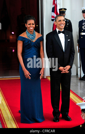 President Barack Obama with First Lady Michelle Obama await the arrival of the British Prime Minister David Cameron during the at the north portico of the White House for a State Dinner in his honor March 14, 2012 in Washington, DC. Stock Photo