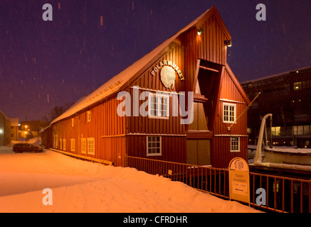 Polar museum at night in winter in the snow Tromso city centre North Norway Europe - Stock Photo