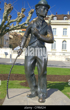 Bronze statue erected in honour of the actor Charlie Chaplin on the lake front at Vevey in Switzerland, where he - Stock Photo