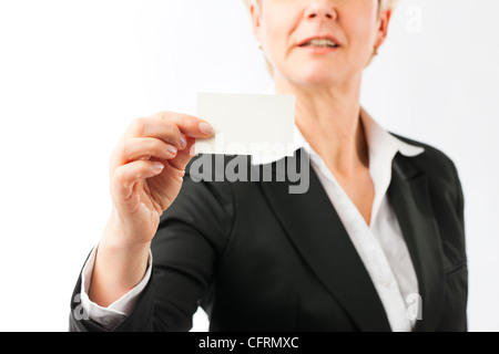 Mature woman showing her business card, closed-up - Stock Photo