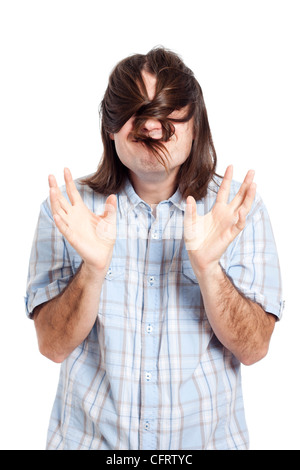Funny man playing with his long hair, isolated on white background. - Stock Photo