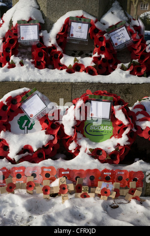 Poppy wreaths laid on the war memorial or cenotaph in Highworth, Wiltshire - Stock Photo