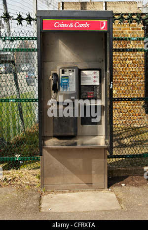 Open Style BT telephone box that takes coins and cards - Stock Photo