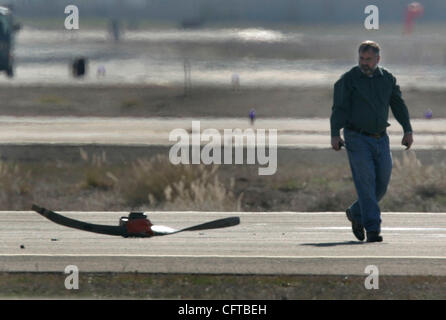 December 31, 2006. San Diego, California, USA_   PETER DRINKWATER, director of County Airports, walks past the propeller - Stock Photo