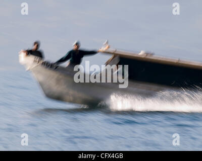 Local transportation boat known as 'launcheros' on Lake Atitlan near Santiago Atitlan, Guatemala. - Stock Photo