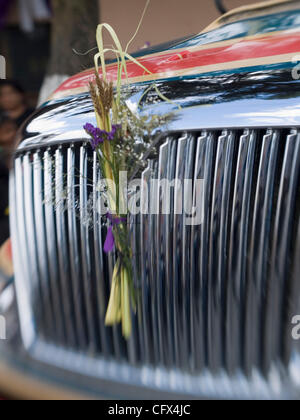 Antigua, Guatemala: Decorations dress up the grill of a bus during the observance of  Lent, before Easter. - Stock Photo
