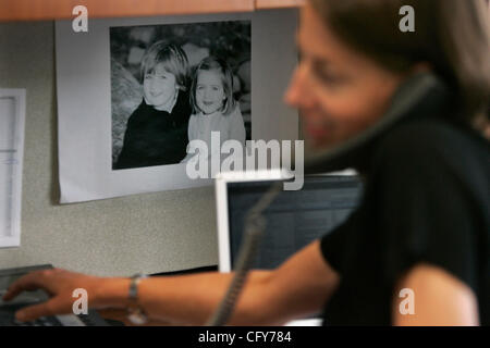 May 9th, 2007, San Diego, California, USA. KIM KENNEDY, director of marketing and communications, works at her job - Stock Photo