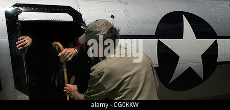 July 6th, 2007 - Blaine, MN, USA -  A crew member helps Eighty-five-year-old Ray Elias, White Bear Lake, off a B - Stock Photo